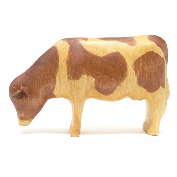grasende Kuh von buntspechte-holzspielfiguren.de.de